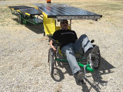 SunPower Vice-President Bobby Ram  sits at the controls of our bike.