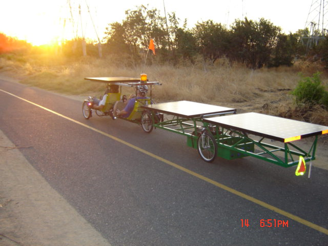 Left rrear view of bike and trailer at sunset.